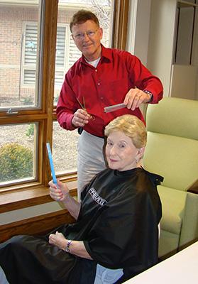 Volunteer Giving A Haircut